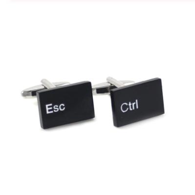 Manžetové gombíky Ctrl + ESC